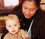 Photo of infant and caregiver