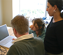 Adults at a computer during professional development
