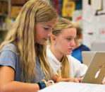 Two female middle school students on computers