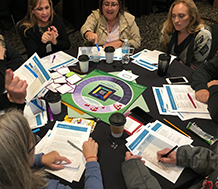 Group of teachers playing Leading Professional Learning: Building Capacity for Sustained Practice, A Simulation Game for Educators