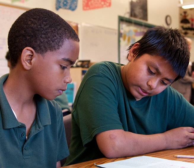 Diverse middle school students learning