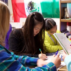 Middle School Students Reading and Writing Together