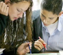 middle to high schoolers communicating with each other in classroom