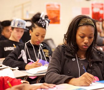 Students in a classroom doing work and learning