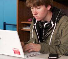 Photo of an adolescent male student at the computer