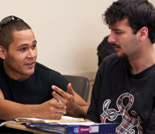 Photo of two male college students working together.