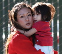 Photo of toddler with-teacher and/or caregiver