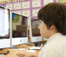 Photo of young student at a computer